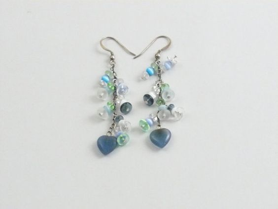 For pierced ears..    French ear wires hold 1 3/4 inch sterling silver chain with small bangled decorations. Each little off shoot is made up of a