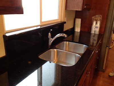 Dark cabinets and stainless steel