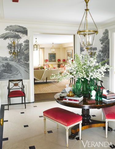 Red benches with black & white scenic wallpaper create an eye-catching entry when paired with this large, round, Empire pedestal table!: