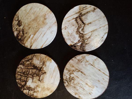 "Set of 4 ""Wood Grain"" design coasters."