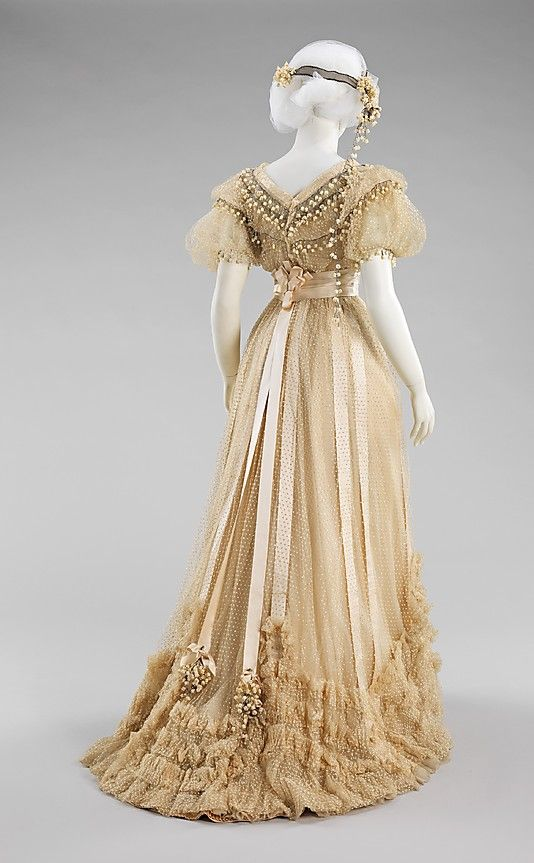 Wedding ensemble House of Paquin (French, 1891–1956) Designer: Mme. Jeanne Paquin (French, 1869–1936) Date: 1910 Culture: French Medium: silk, cotton, beads                                                                                                                                                      More