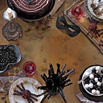 Throw a grown-up Halloween bash and invite your pals over for an elegant evening in?and make room for a few creepy-crawly friends.