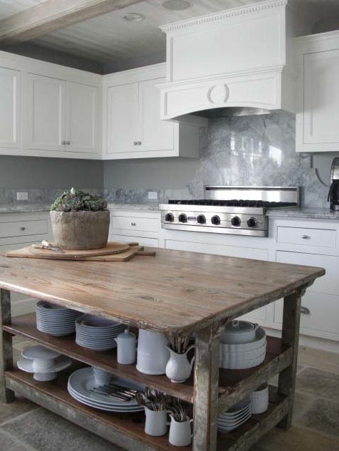 love using an old table as a kitchen island