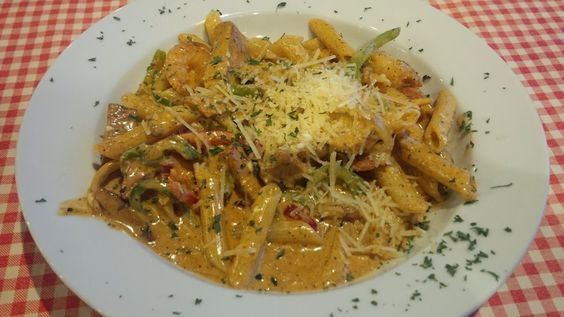 JAMBALAYA PASTA Blackened Cajun chicken breast, shrimp, andouille ...