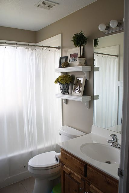 Bathroom shelves-- might take down those bland metal ones and do this!