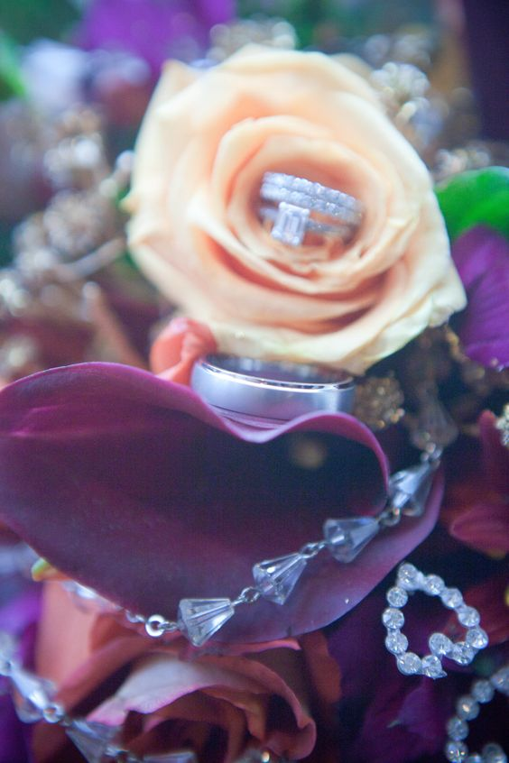 photography.  wedding rings in bouquet