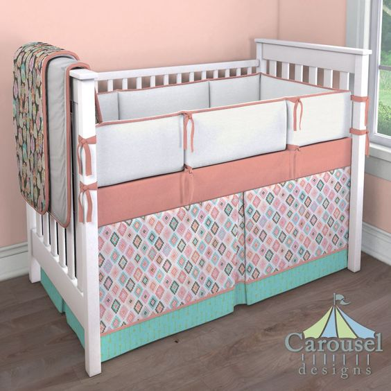 Girl Crib bedding in Solid White Minky, Solid Light Coral, Pastel Tribal, Aqua and Gold Arrows, Solid White, Blush and Gray Feathers. Created using the Nursery Designer® by Carousel Designs where you mix and match from hundreds of fabrics to create your own unique baby bedding.