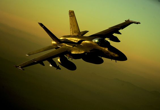 A U.S. Navy F/A-18 Hornet maneuvers into position for aerial refueling from a U.S.Air Force KC-10 Extender