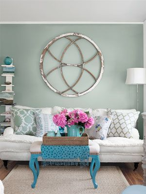 Rustic Old Window Frame As Wall Accent..the round shape is very dramatic...