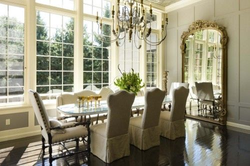 This dining room is gorgeous!!!!  I love the mirror, lights, and chairs.