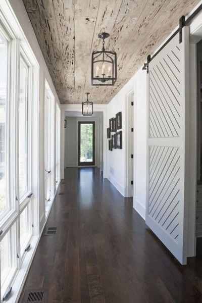 Barn Door and pecky cypress ceiling in a modern farmhouse. Rachel Halvorson Inspired Decorating Tips. #entry #barndoor #rusticdecor #farmhouse #peckycypress