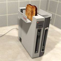 Great for any break room: Recycled Nintendo console transformed into a fully operational toaster.