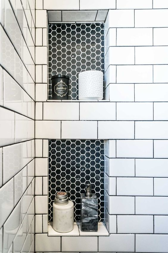 These subway tiles are all white but they surround a little bit of accent with the black honeycomb insert. It definitely creates a stylish look and draws your attention when you enter the room.