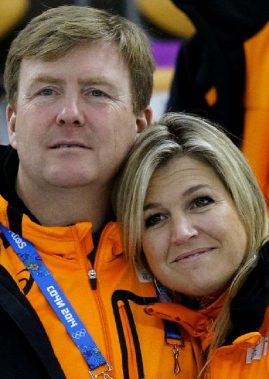 Dutch King Willem-Alexander and Queen Maxima hug each after country skater Margot Boer won a bronze in the women's 500-meter speedskating race at the Adler Arena Skating Center at the 2014 Winter Olympics, 11.02.14, in Sochi, Russia.
