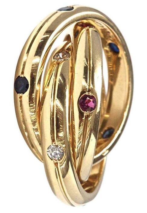 Anillo Trinidad de Cartier; oro, diamante, rubí y zafiro.