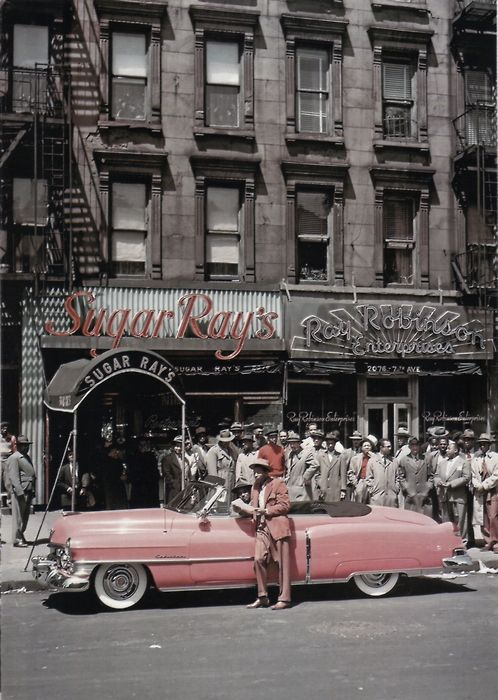 Sugar Ray and his flamigo pink caddy on 124th Street in Harlem outside his club.