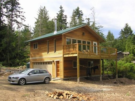 This small 576 square foot house is located on Gabriola Island in British Columbia and has two stories, a 24′ by 24′ footprint, type-3 septic field, instant hot water heater, and cork floors.