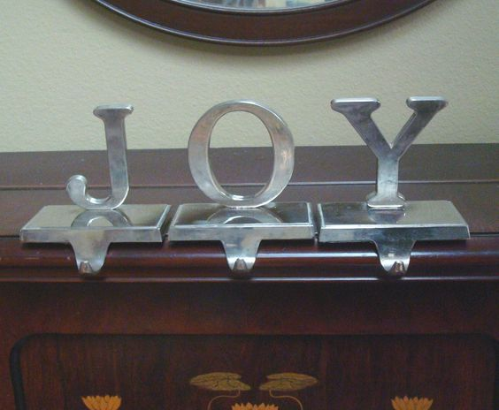JOY silver finish Christmas stocking holder set of 3 hangers...found at GW for less than a dollar each...plan to spray to match fireplace mantel..