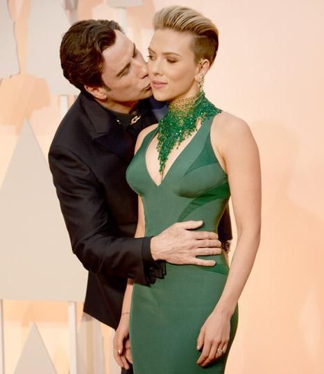 An unsolicited smooch from John Travolta on her cheek in an apparent photobomb - Oscars 2015