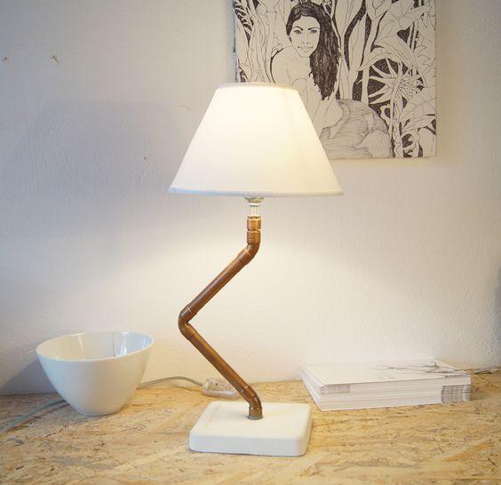 Φωτιστικό Kikwit Χάλκινα υδραυλικά εξαρτήματα  Βάση απο τσιμέντο Ντουί για λάμπα Ε14  Διαστάσεις 14x12cm, ύψος 35cm, 1Kg Περιλαμβάνεται το καπέλο