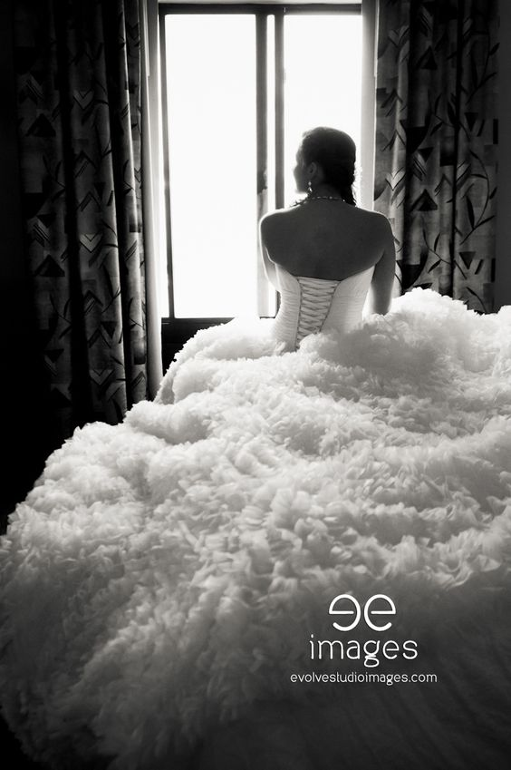 Montana Wedding-Dramatic lighting of bride and the back of her dress, in her hotel room.
