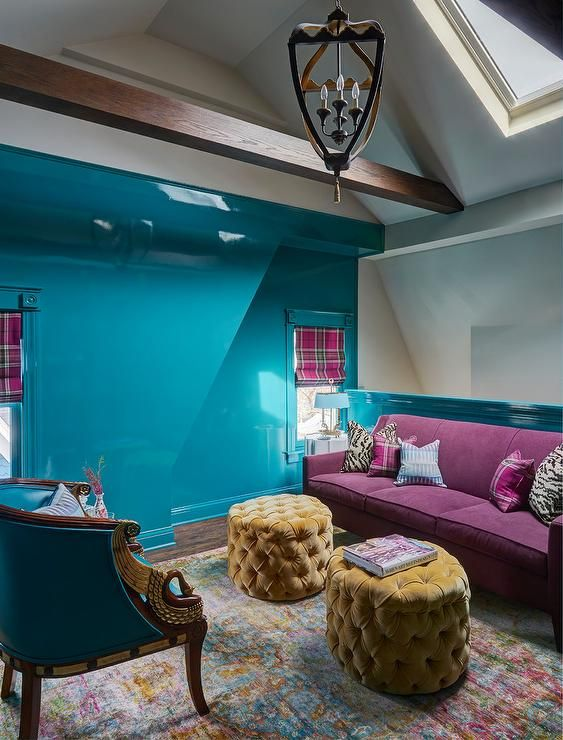Gold Tufted Pouf Ottomans In A Bold Turquoise Blue Living Room Showcasing A Lovely Aubergine Purple Sofa An Lacquered Walls Monochromatic Room Blue Living Room #purple #and #blue #living #room