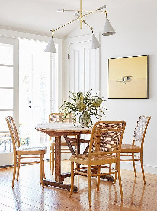Beautiful neutral breakfast nook with cane back Hoffman chairs, vintage table and modern light fixture - Jenni Kayne #kitchen #dining #nook