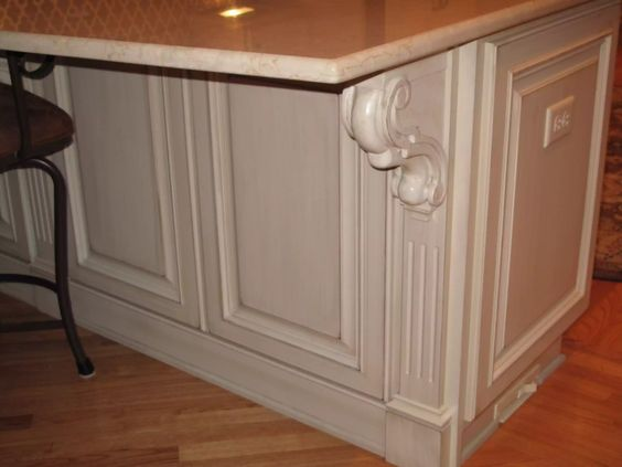 Custom White Painted Kitchen Peninsula with Corbeled Detail