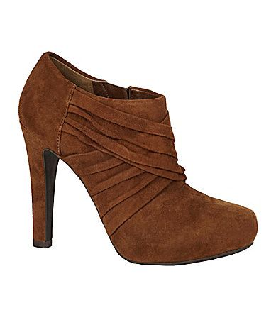 I just bought these in this brown and in black. $18.00 each at Dillards.  What a deal!