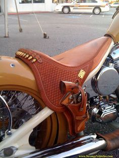 STRANGE MOTORCYCLE SADDLE W/ SIX GUN - HOLSTER AND BULLETS!
