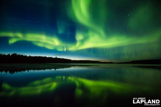 Auroras reflecting in a lake in Rovaniemi, Lapland.