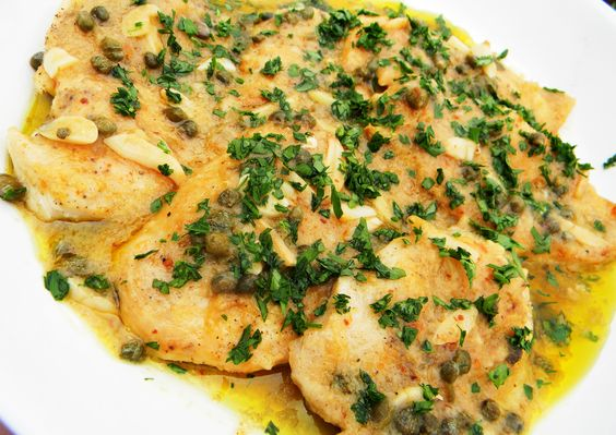 chicken aglio e olio - cutlets seasoned & floured, then sauteed in olive oil and butter with garlic, peperoncino, and capers, then red wine vinegar and broth; bread crumbs to thicken the sauce...fresh parsley.