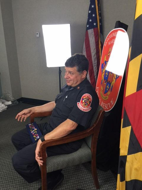 Firefighter Roger Marks sitting in interview chair