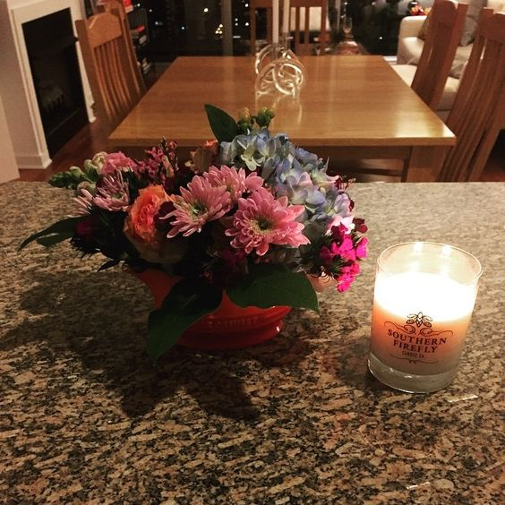 Thank you @malaelizabeth for the gorgeous spring flowers! #southernfireflycandle #lecreuset by kristyleigh7186