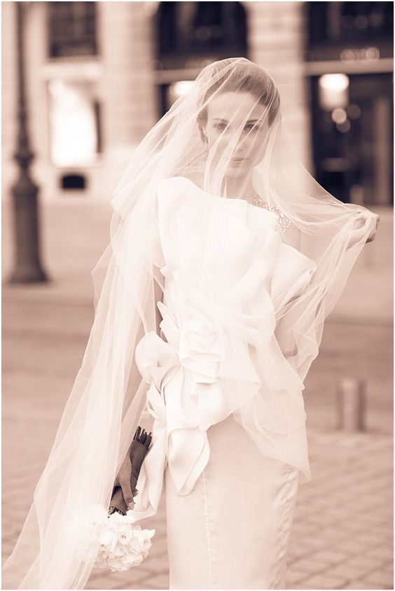 Oversize wedding veil | Image by Le Secret d'Audrey, see more http://www.frenchweddingstyle.com/paris-wedding-inspiration/