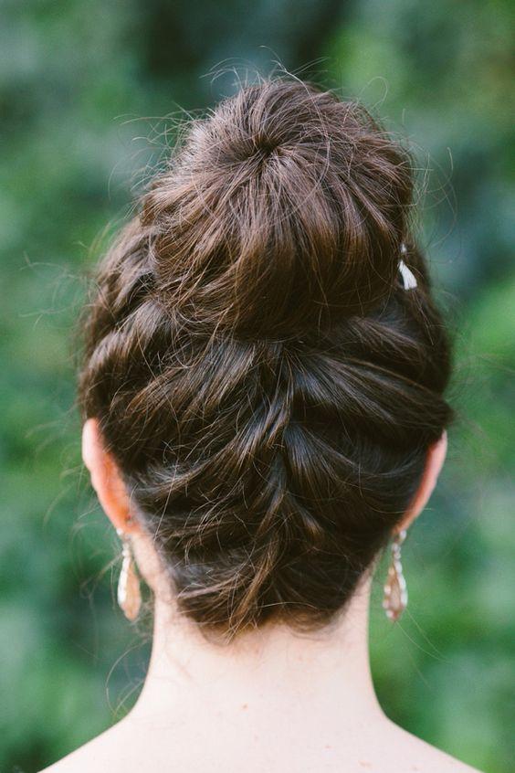 braid + topknot, photo by Lad  Lass http://ruffledblog.com/villa-paradiso-wedding #wedding #hair #bridalhair