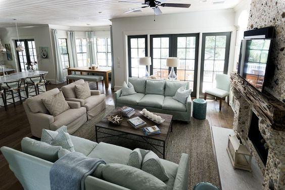 Amazing Open Plan Living Room Features Beadboard Ceiling Accented With Ceili Living Room Furniture Layout Furniture Placement Living Room Open Plan Living Room