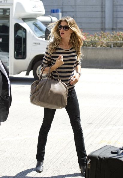 Airport style-  she looks good in anything.