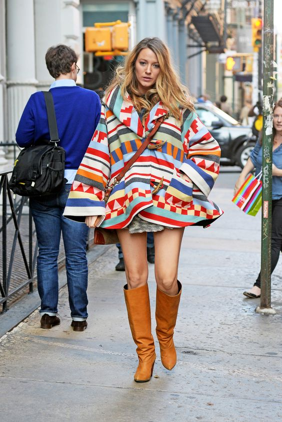 Blake Lively's maternity style: wearing a large cloak/cape, the focus is on her legs.