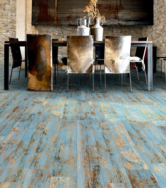 Obsessed with this worn wood look floor from Mettro Source. It's porcelain tile!