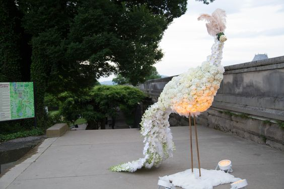 Peacock floral arrangement for a Gatsby-themed wedding at the Biltmore Estate in Asheville, NC. Blossoms Floral