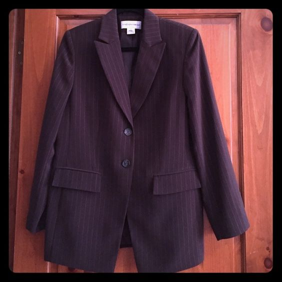 Jones NewYork Suit Jacket size 10 This lightly used suit jacket is the perfect item for dressing up jeans or complimenting your favorite pair of dress pants. Two buttons, functioning pockets, chocolate brown with light tan pinstripes. Jones New York Jackets