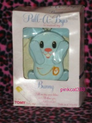 VTG TOMY PULL-A-BYES MUSICAL TOY~BUNNY~BABY BLUE~PLAYS PEEK-A-BOO~BRAHMS LULLABY