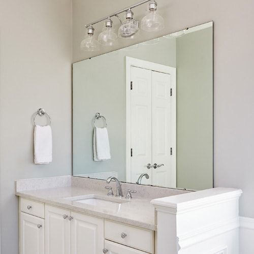 Newly Remodeled Bathroom With White Vanity And Updated Lighting