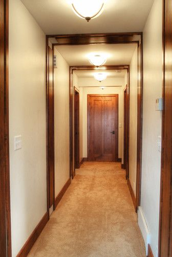 Mission style hall traditional hall - lighting fixtures + wood trim