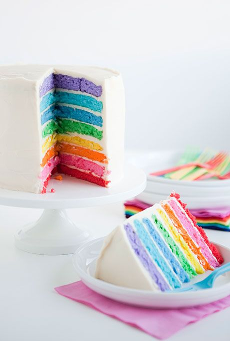 Brides.com: All Things Rainbow. A humble buttercream-frosted cake that reveals brightly colored layers once you slice into it is a must. Click here to see more rainbow wedding cakes.Cake by One Charming Party