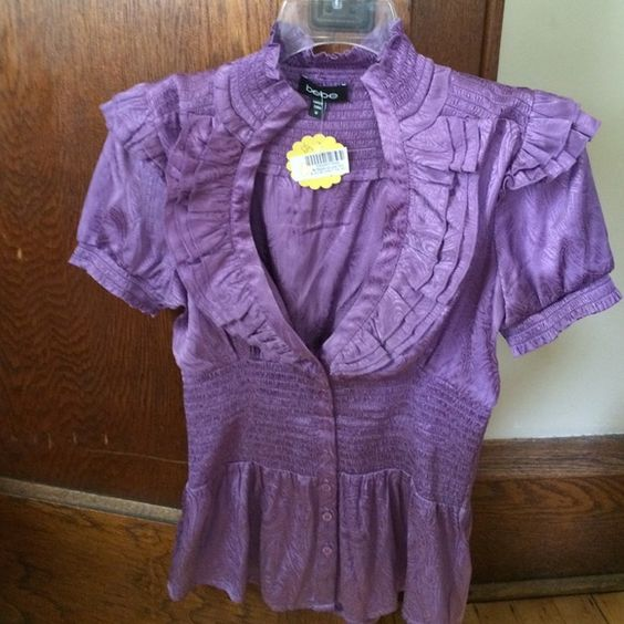 Bebe purple shirt size medium.  Worn once. Purple shirt . Bebe brand. Worn once. Excellent condition! New price bebe Tops