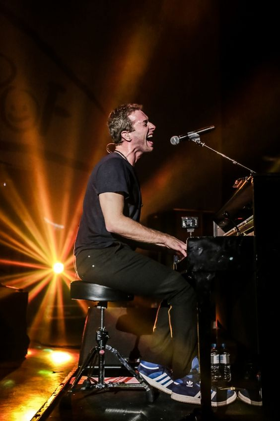 Now that's what we call a rush of blood to the head. Current GRAMMY nominee Chris Martin of Coldplay digs in for a performance at the Under 1 Roof concert on Dec. 19 in London