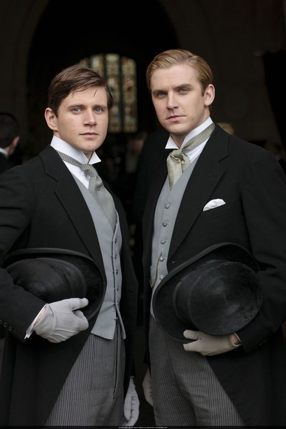 The Morning Suit is the equivalent of White Tie before 6 P.M.  Coats are black or grey with single button at the waist and cut away to broad tail at back. This style is typically accompanied by a wing-collared dress shirt, ascot, and striped trousers, but can be made less formal by pairing with a tie.