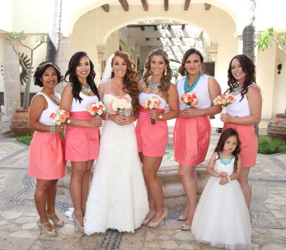 Beautiful Bridesmaids and Flower Girl! Coral skirts, white top and turquoise necklaces or their choice.